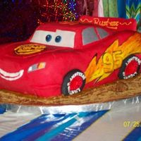 "Lightning Mcqueen Birthday Cake   Lighting McQueen was approx 7""x12""...on a 16"" base."