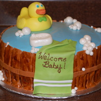 Rubber Duck Cake Inside is white cake with chocolate hazelnut mousse and chocolate buttercream. All decorations are MMF (even Mr. Ducky!), with luster dust...