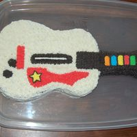Guitar Hero Cake I made this kinda-ugly cake for my brother's birthday (hey, guys don't care what it looks like as long as it's tasty, right...