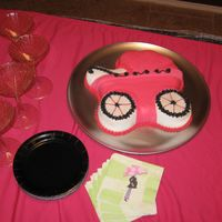 Hot Pink Baby Carriage I did not make this cake, but it was made for my baby shower by a good friend. She used the Wilton baby carriage pan and Wilton fondant...