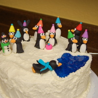 "Penguin Party 9"" round, buttercream with fondant penguins for my daughter's first birthday. There's even an imposter bunny rabbit ""..."