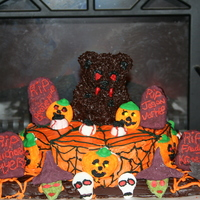 2010 Spooky Cake Contest This is my First Halloween Cake, It Took a week and a half to make with some challanges, I used Royal icing for the halloween modeling...