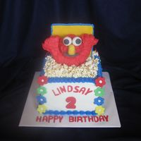 Elmo, Lindsay And Popcorn This may look familiar to you.. the first time, I forgot to post the picture that had the popcorn. This cake was a sheet cake that was...