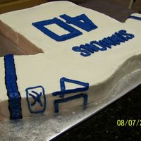 Dallas Cowboys   Pound cake with buttercream. For clent's husband turning 40 and a huge cowboy fan.