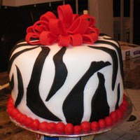 Zebra This cake was so much fun! 3 8in round strawberry layers, cream cheese icing under the fondant. I guess thats why people use buttercream or...