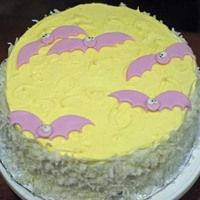 Going Batty On Halloween! Covered in buttercream with coconut on the sides, and fondant bats on top.