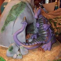 Dragon Cake I made this for my niece's graduation party. She loves Dragons. I wanted to put a little coiled up diploma in the cake area with the...
