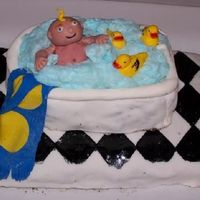 "Connor's First Ever Cake This cake was made for my friend Heather's baby shower. The theme was boy and duckies. The ""bubbles"" are made out of cotton..."