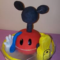 Mickey Mouse Club House This is The Mickey Mouse Club House Cake. I did it for my friend's baby's first birthday party. It's a vanilla cake with...