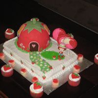 Strawberry Shortcake At Home Fondant covered house, buttercream covered scene. Trees made from chocolate melts.