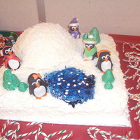 Winter Wonderland i made this cake for our Christmas party at work, vanilla, smbc, coconut, i made the pengiuns out of rkt, fondant and accented them with...
