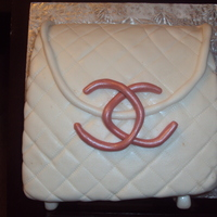 Chanel Clutch Cake chocolate cake, smbc covered in fonant and luster dust thanks for looking