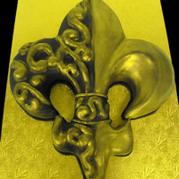 Black And Gold Fleur De Lis The fleur de lis was carved out of a full sheet, decorated with fondant accents and painted with gold luster dust.
