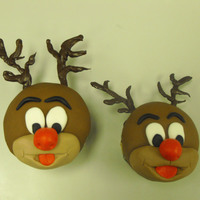Rudy Fondant Rudolph cupcakes with chocolate antlers.