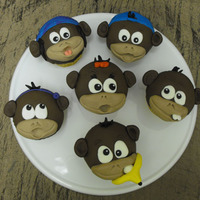 Bunch Of Monkeys! I made these monkey cupcakes for my mom on her birthday a couple weeks ago. Each monkey is supposed to resemble a certain characteristic of...
