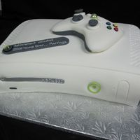 Xbox 360 The cake is covered in fondant and the controller was made out of fondant :)