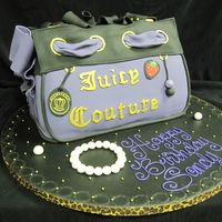 Juicy Couture Purse This Juicy purse is covered in fondant, with fondant accents. The letters were cut by hand.