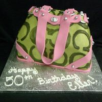 Coach Bag Cake The cake was covered in buttercream and all the hardware was made of fondant :)
