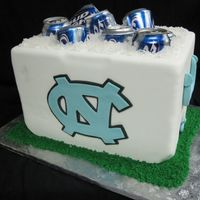 Unc Cooler Cake There's nothing better than cake AND beer for a grooms cake! The cake is covered in fondant, the UNC logo and cooler accessories are...
