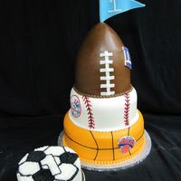 Sports Birthday Cake This cake was for a little boys 1st birthday. Each tier was a different NY sports team and there was a small soccer smash cake. ....I think...