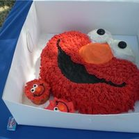 Elmo Cake Chocolate Cake with BC Icing. Used the hair/grass tip to decorate instead of stars- wanted a more realistic look. For my grandson's...