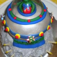 Spaceship Alien Cake My 8 yr old son wanted a spaceship with an alien landing on the moon cake. :)