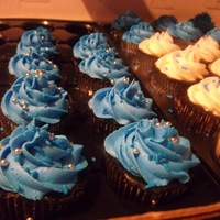 Graduation Cupcakes   Cupcakes that went along with the cake for Morgans Graduation. Cuppies were choc.and vanilla with buttercream.