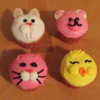 Animal Cupcakes   I copied these designs from the Wilton site: bunny, teddy bear, cat and chick