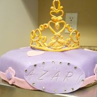 Princess Azari This is my version of the pillow cake. Its is an octagon shape with a button in the middle topped with a gumpaste tiara. This is my 1st...