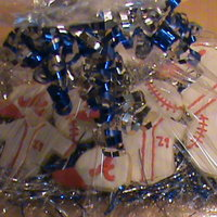 Baseball Cookies Sugar cookies with Wilton color flow icing.