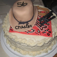 Western Cake white cake with cream cheese frosting, everything else on top is fondant (hat, hanky, branding irons, rope