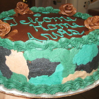 Welcome Home From Army Cake made for my friend to give to her husband back from afganistan, a camoflouge side...all buttercream, and first time tootsie roll roses and...
