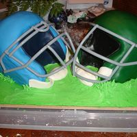 Football Helmet Cakes (My very first fondant covered cake) One chocolate, one white cake. Covered in MMF fondant with BC transfer emblems. This cake was for a...