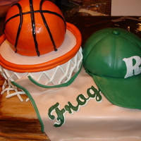 Basketball Groom's Cake Stupid basketball gave me FITS! Sadly enough I ended up giving up and plunking it on there anyway. ugh... my favorite part was the hardwood...
