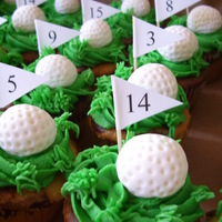 Golf Themed Cupcakes The golf balls are made of fondant and each dimple was put on by hand! I made 60 of them.