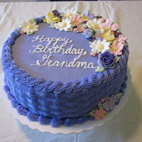 Purple Flower Basket Anniversary Cake for a couple celebrating their anniversary. the flowers are royal icing