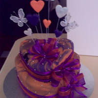 Two Tier Heart Wedding Cake Two Tier Heart Wedding Cake.Colour Scheme - Orange, Purple and a touch of Black.I made marble fondant with orange, purple and a touch of...