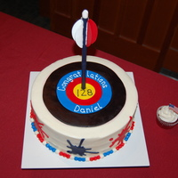 Archery Cake For an Eagle Court of Honor reception. The eagle scout loves archery and graphic design. The ink splats on the side of the cake match his...