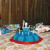 Melissa And Melody's 5Th And 3Rd Birthday Cake A blue birthday cake that I made with a doll and a bundt cake. I didn't have the wonderpan at this point. I didn't have much of...