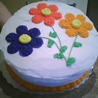 Flower Cake I made this for a co-worker who wanted to surprise a fellow co-worker for her birthday. Got the idea from Wilton Course 1 book. The cake...