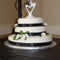 My First Wedding Cake I have my made my first official wedding cake. It was a 3 tier fudge marble cake. The bride's colours were black and white and her...