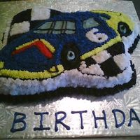 Race Car I made this car cake for a friend who was turning 6. I also made a couple Lightning McQueen cakes to go with it.