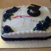 Graduation Graduation cake - school colour is dark purple. Vanilla cake with a raspberry filling.
