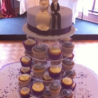 Cupcake Tower Full cupcake tower with personalised people on cutting cake