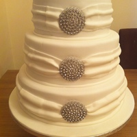 Diamante Brooches With Swags 4 tiered cake with full swags on each tier, diamante brooche on each layer