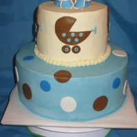 Blue & Brown Baby Cake   Buttercream icing with fondant accents and booties on top.