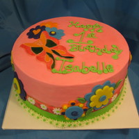 Butterfly Flower Cake Buttercream icing with fondant accents, & ribbon.
