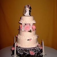 My First Wedding Cake  I gifted this cake to my cousin and her new hubby. the bottum layer is choco w/ raspberry cream filling. the middle is white with peach...