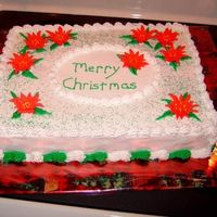 Christmas Concert Cake   royal icing pointsetas, buttercream for everything else.