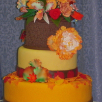 Thanksgiving dummy cake for class with Collete Peters. Gum paste flowers with fondant leaves.